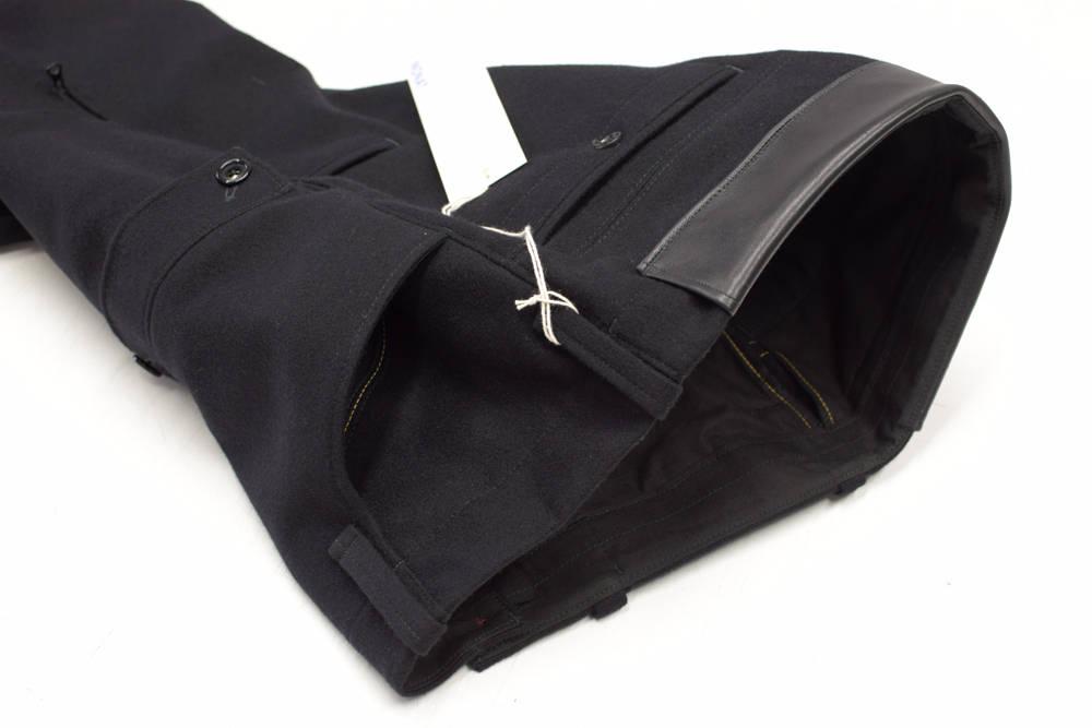 Sonderanfertigung einer Lodenhose von INDNAT für einen Bergsteiger in Innsbruck, Lederbesatz, schwarze, Lodenhosen